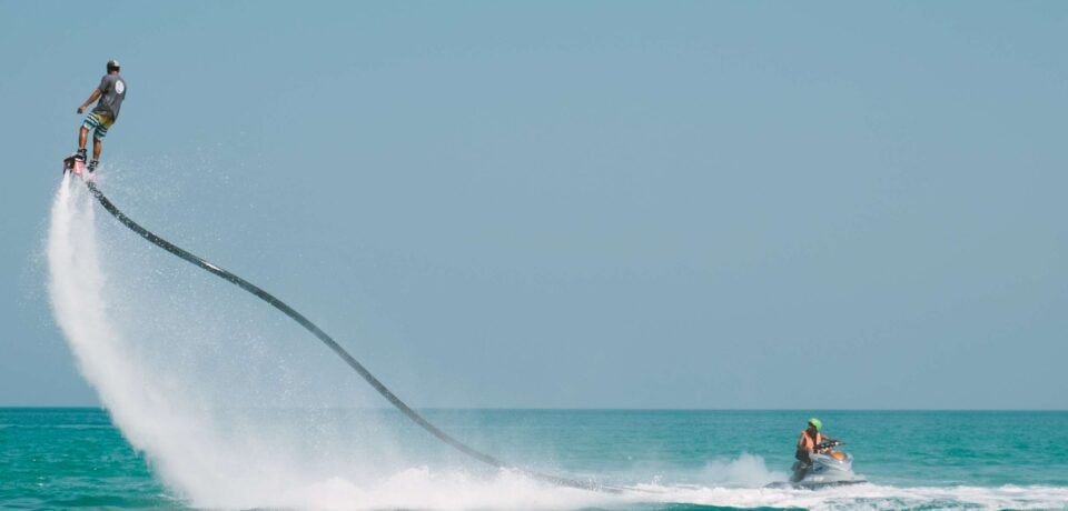 How can you play Destin water sports easily?